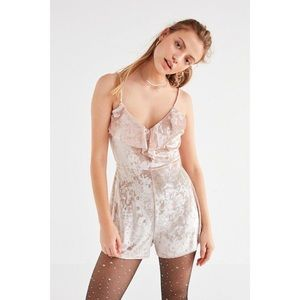 Creme velvet romper from urban outfitters